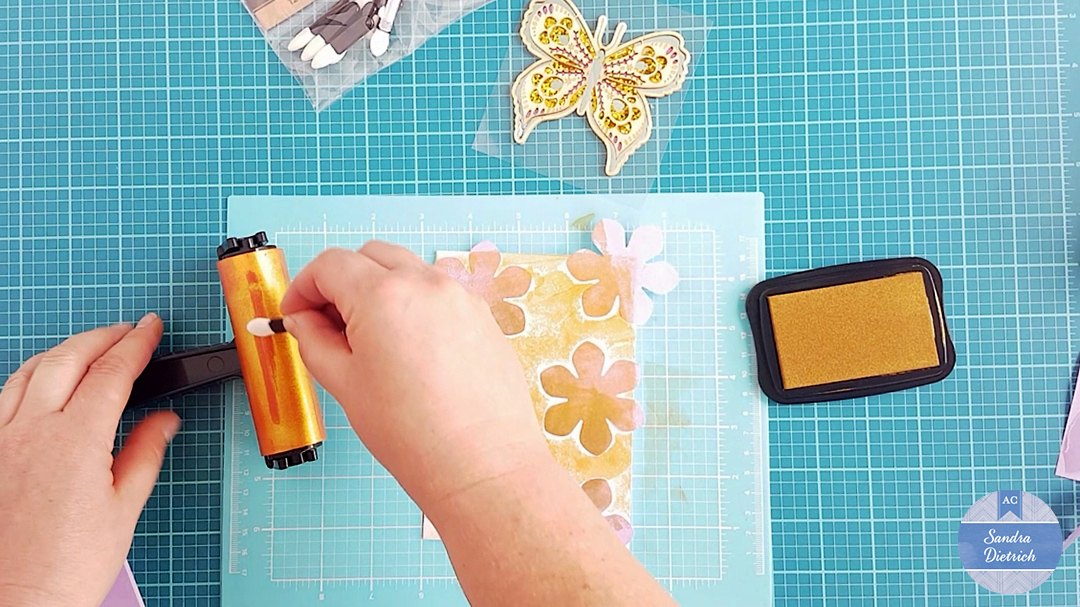 Get some ink onto the chalk applicator by dipping it onto the brayer.