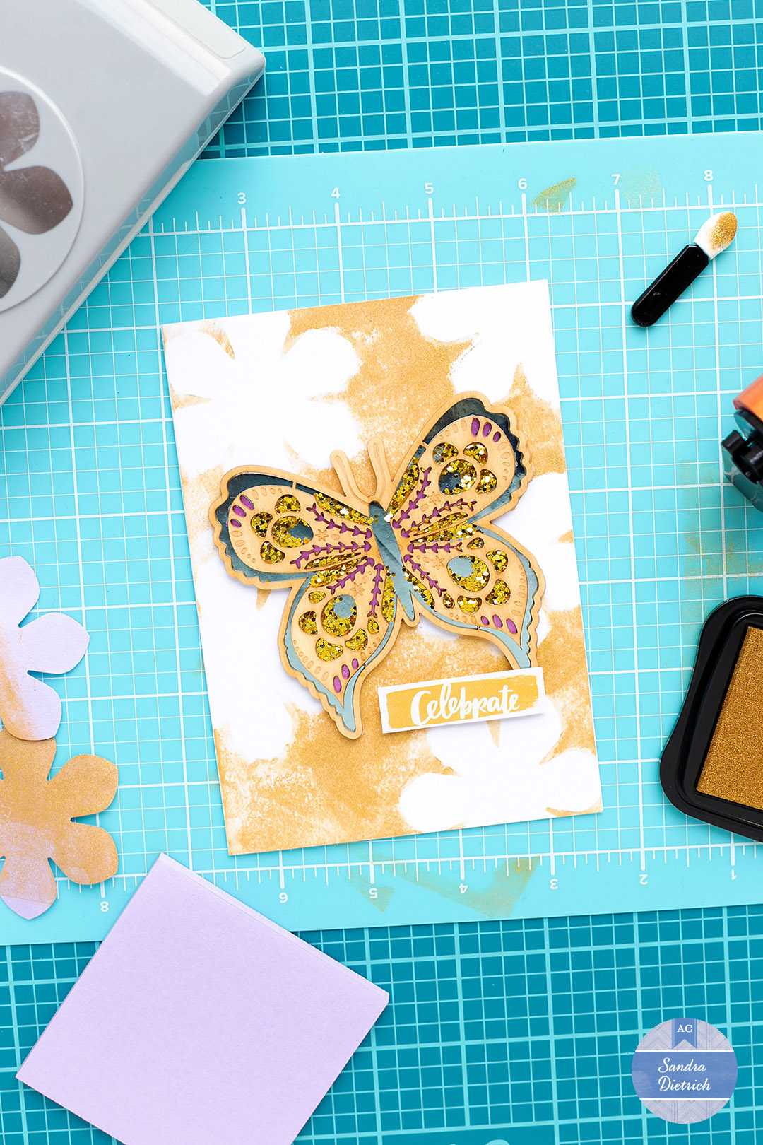 The card is finished. The photo shows the card with a large butterfly embellishment.