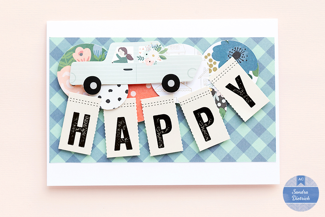 A pretty Fall card saying Happy. The card holds circle embellishments and a fun car embellishments.