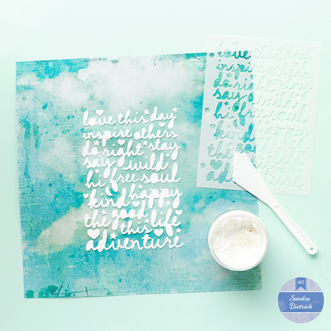 The image shows a scrapbook page with a customized background. It also shows a stencil, embossing paste and a palette-knife.