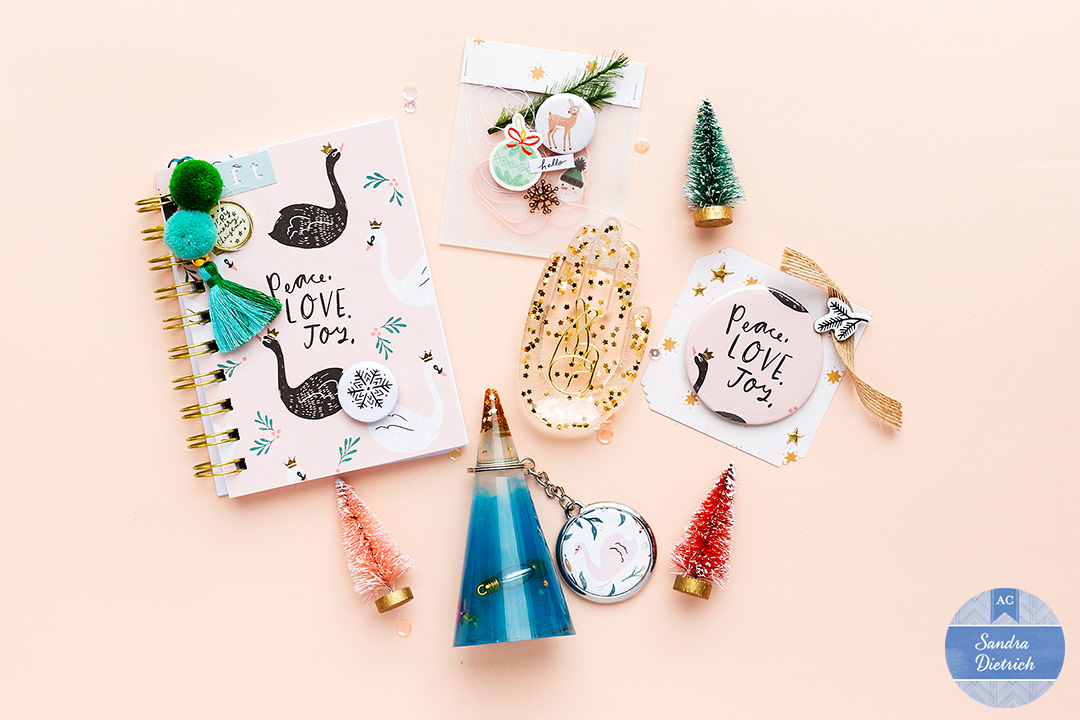 Christmas gift inspiration at a glance. Notebook, resin hand and resin key-chain holder, vellum gift bag and Christmas flair button.