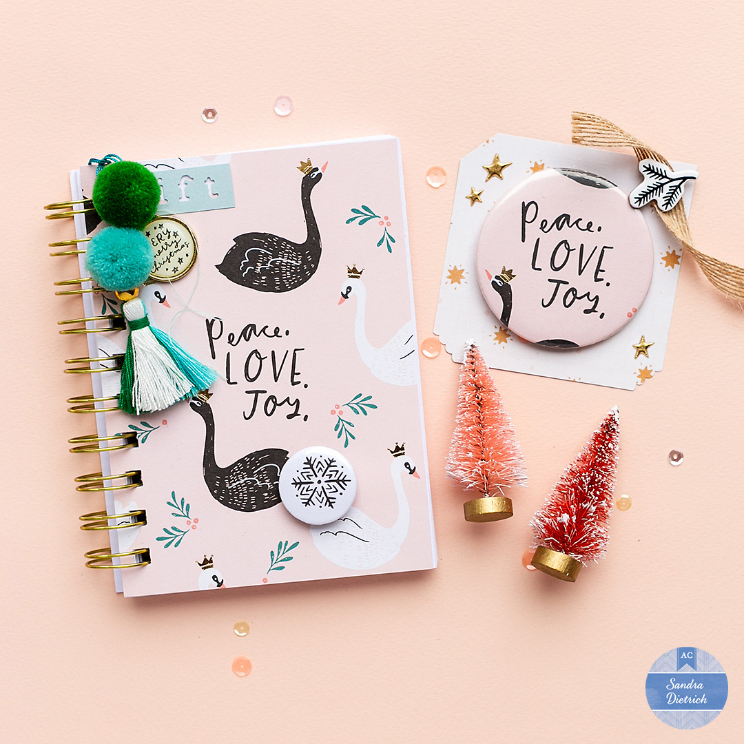 Handmade notebook and coordinating flair button with a tassel and paper by Crate Paper.