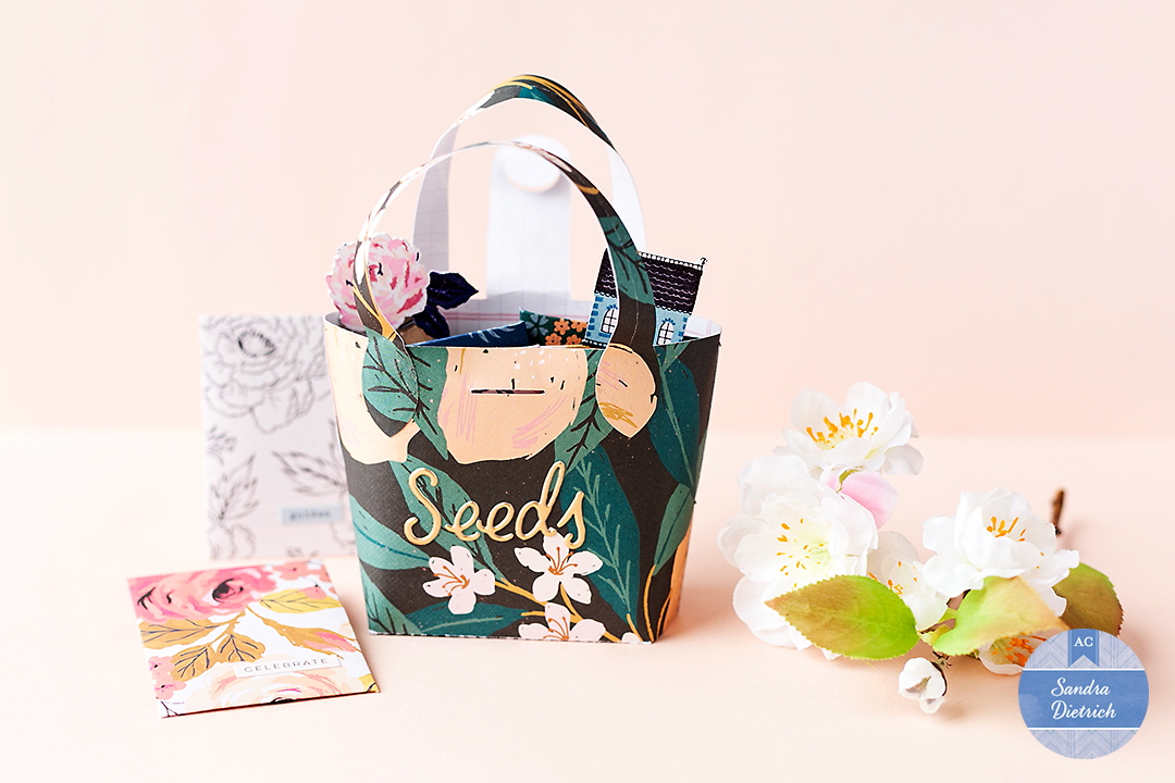 Stylish Seed Storage a purse made with the Marigold Collection showing the title 'seeds' and two pockets to store flower seeds