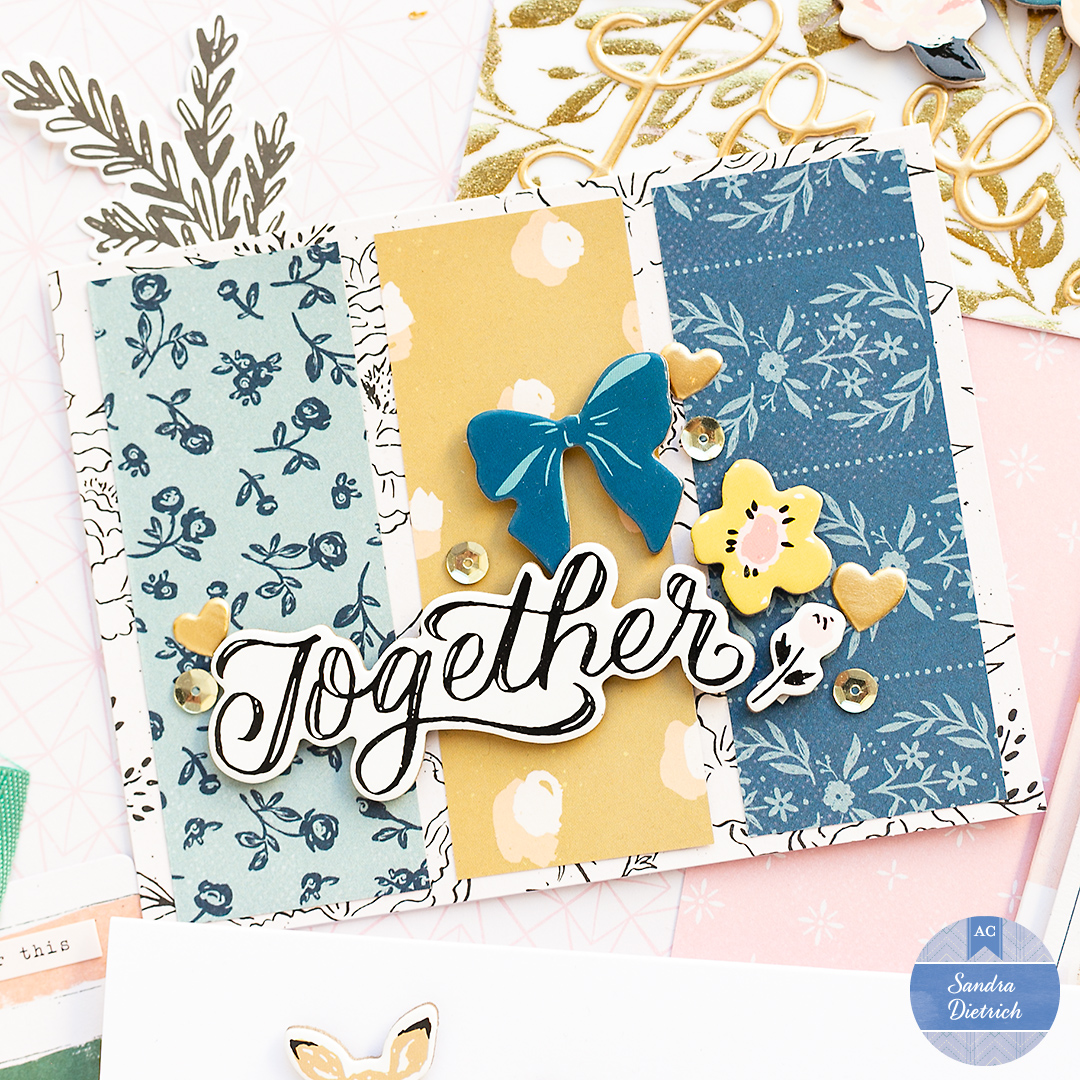 Card with three paper strips. The card says TOGETHER. And it has cute chipboard stickers as decorative elements. Golden sequins completed the design of this Valentine's Day card.